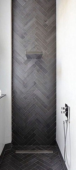herringbone design on waterfall shower wall remodel of tub replacement and regrout clean tile steam near me tile installers near me tile boulder